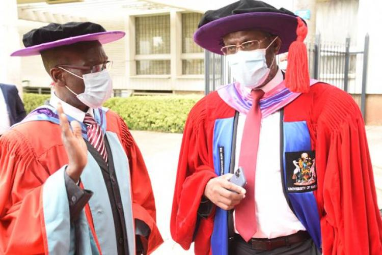 PROF .Kiama having a chat with Prof ogeng'o