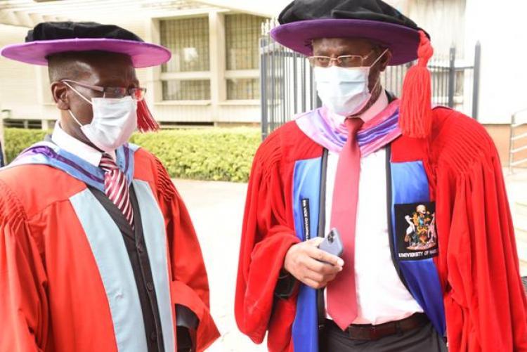 Prof. Ogeng'o and prof . Kiama having a talk